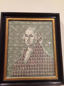 A portrait of George Washington made out of dollar bills sewn together!