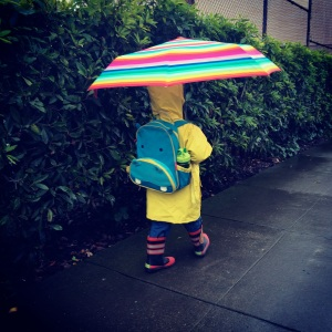 Boy in the rain.