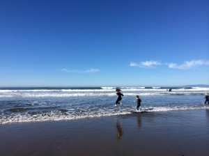 Gratuitous kids frolicking in the ocean on the last day of January photo.